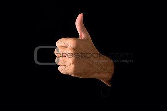 Thumb up on dark background