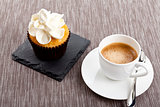 tasty sweet cupcake and hot aromatic espresso coffee
