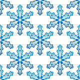 Seamless pattern with blue snowflakes