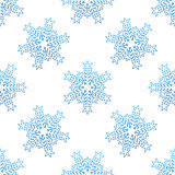Seamless background with blue snowflakes