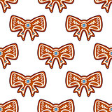 Gingerbread bows seamless background