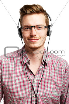 Listens and smiles with headphones