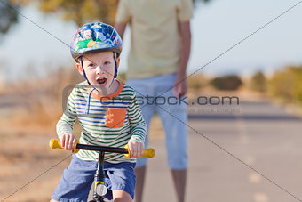 little boy biking