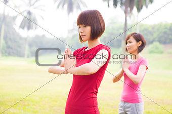 Asian girls yoga at outdoor