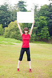 Outdoor Asian girl with placard