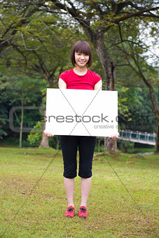 Asian girl holding a placard outdoor