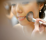 Asian bride applying wedding make-up