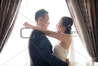 Asian Chinese wedding couple dancing