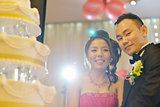 Asian wedding cake cutting