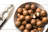 macadamia nuts with nutcracker