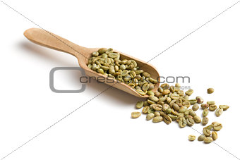 green coffee in wooden scoop