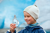 Boy with ice piece near Nigardsbreen glacier (Norway)
