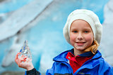 Girl with ice piece near Nigardsbreen glacier (Norway)