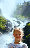 Portrait girl on summer waterfall background