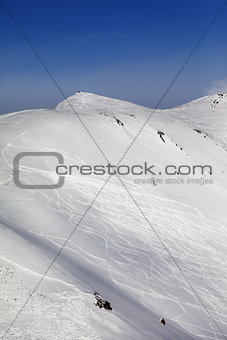 Off-piste ski slope with traces