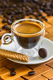 cup of italian espresso with biscuit and almond in chocolate