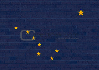 Alaska State Flag on brick wall