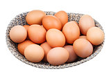 many fresh chicken eggs in wicker basket