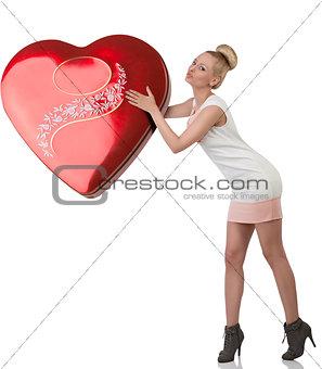 blonde female kissing big gift
