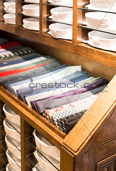 Ties stacked on a shelf in a store