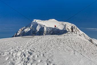 climbing the mountain in winter