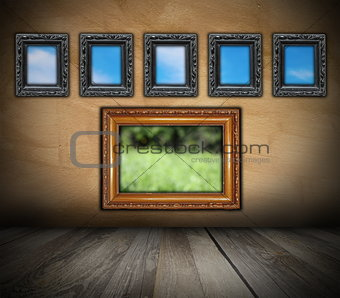 ancient wooden frames on grunge wall