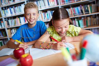 Classmates making notes