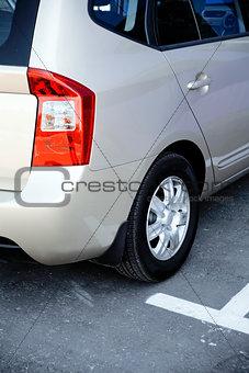 grey metallic modern passenger car on parking