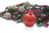 Christmas red ball and twig of fir