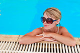 girl in blue water pool in glasses Sun Protection