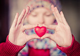 Heart shape love symbol in woman hands with face on background Valentines Day romantic greeting people relationship concept winter holiday