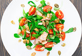 Salad with arugula, salmon and cherry tomato