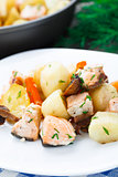 Baked salmon with potato, mushrooms and carrot
