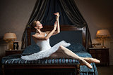 ballet dancer in bedroom and holding pearl necklace