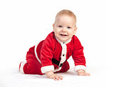 Happy little baby boy in Santa costume
