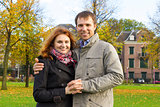 Outdoor happy couple in love posing in Museum Plein, autumn Amsterdam