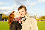 Outdoor happy couple kissing in Museumplein, Amsterdam