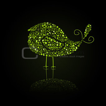 Green Bird Silhouette Composed from Go Green Eco Signs on Black Backdro