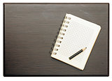 Blank notepad with pencil on wood table closeup