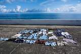 Drying clothes on the pavement at seafront in Baracoa