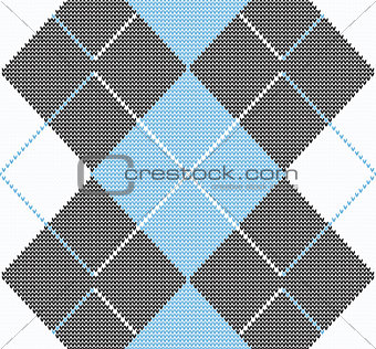 Knitted winter background with rhombus. seamless