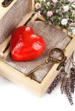 red heart with key in retro box
