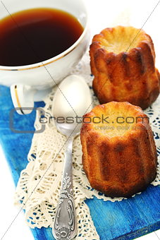 French small cake and cup of tea.