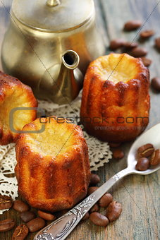 Cake canneles and old coffee pot.