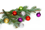 Many colored balls on the fir branch of Christmas tree