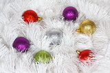 Christmas wreath of tinsel and colored balls as a texture