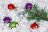 Christmas wreath of tinsel and colored balls with pine branch