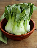 Bok choy (chinese cabbage) on a wooden table