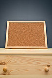 Cork memory board on wooden cabinet