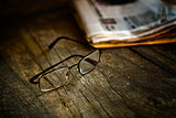 Rading glasses and newspaper